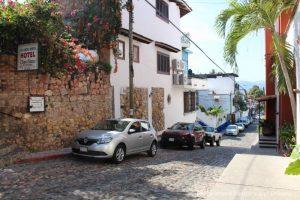 The Colourful Architecture and History of Gringo Gulch, Puerto Vallarta, Mexico: cobblestoned street and Chez Elena