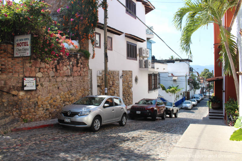 The Colourful Architecture and History of Gringo Gulch, Puerto Vallarta, Mexico: cobblestoned street and Chez Elena