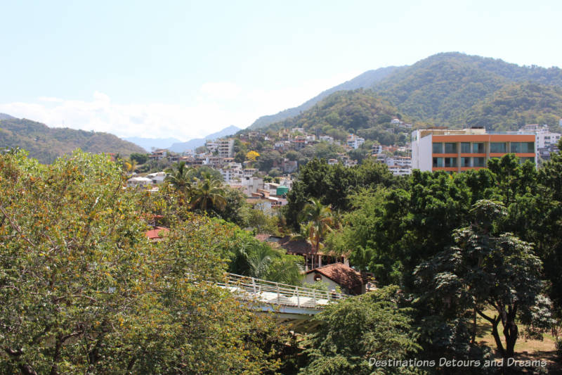 The Colourful Architecture and History of Gringo Gulch, Puerto Vallarta, Mexico: view of hills across Rio Cuale