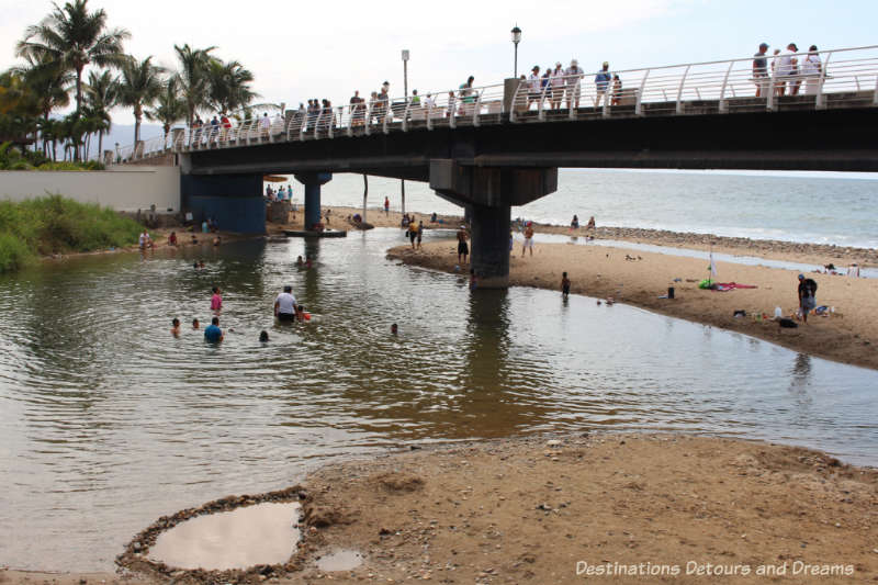 Children playing in the Cuale River where it joins Banderas Bay in Puerto Vallarta