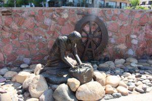 Washerwomen sculpture by Jim Demetro near Isla Cuale: Puerto Vallarta's Island Oasis