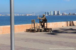 Strolling the Puerto Vallarta Malecón: living statue imitating a sand statue