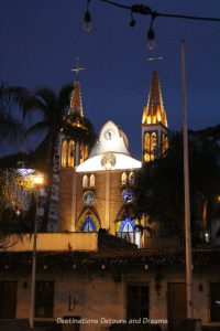 Our Lady of Refuge Church in Puerto Vallarta lit up at night