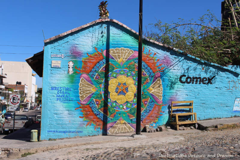 A Restore Coral Mural Project mural by Honhikuri in Puerto Vallarta features circular designs in turquoise, yellow and red