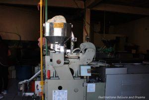 Tortilla making machine in a small tortilla bakery in Puerto Vallarta