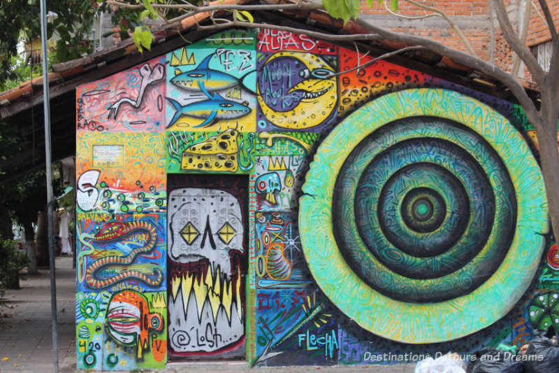 Puerto Vallarta street art: an eclectic collection of graffiti-like swirls on a building in the Romantic Zone