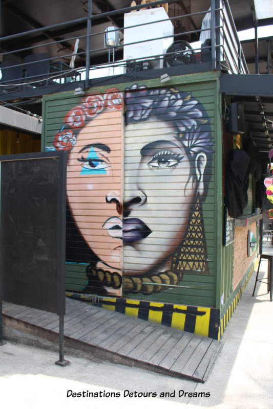 Puerto Vallarta street art: divided face of man/woman