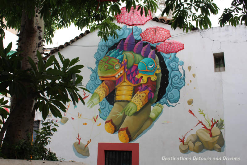 Puerto Vallart street art: puffy, kneeling sea creature