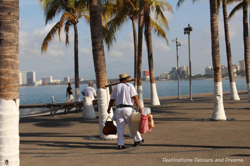 Vendor selling tuba along Puerto Vallarta's Malecón