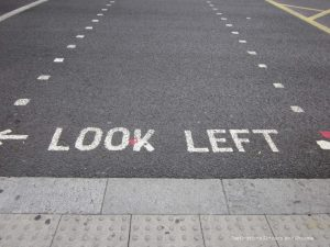 Look left sing on curb in London - things to know when travelling to England