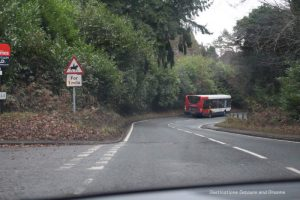 Bus on a country road in eastern Surrey, England