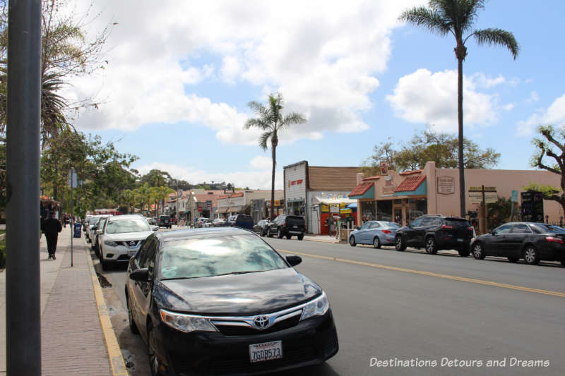 Street lined with historical buildings and palm trees in Old Town San Diego neighbourhood