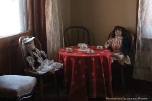 Rossoon House: dolls at tea party in girls' bedroom