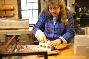 Woodcarver Pam Greesham carving at Silver Dollar City
