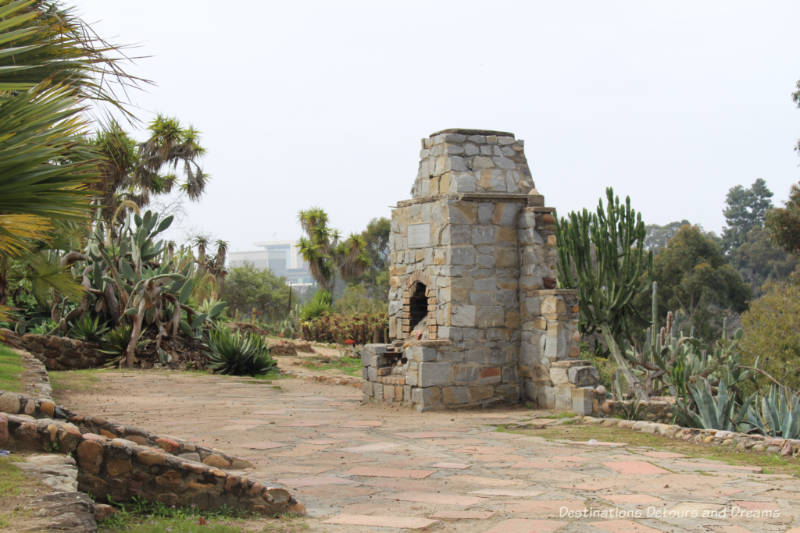 Cacti and stone fireplace in Old Cactus Garden in Balboa Park