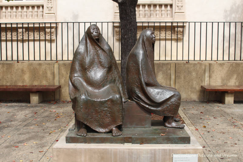 """Mother and Daughter Seated"" sculpture"