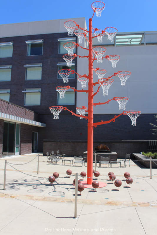 A pole with many basket hoops is an art installation outside 21c Museum Hotel in Bentonville, Arkansas