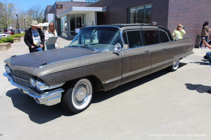 Making Change art installation by Monica Mahoney is a 1962 Cadillac covered with dimes, nickels, and pennies