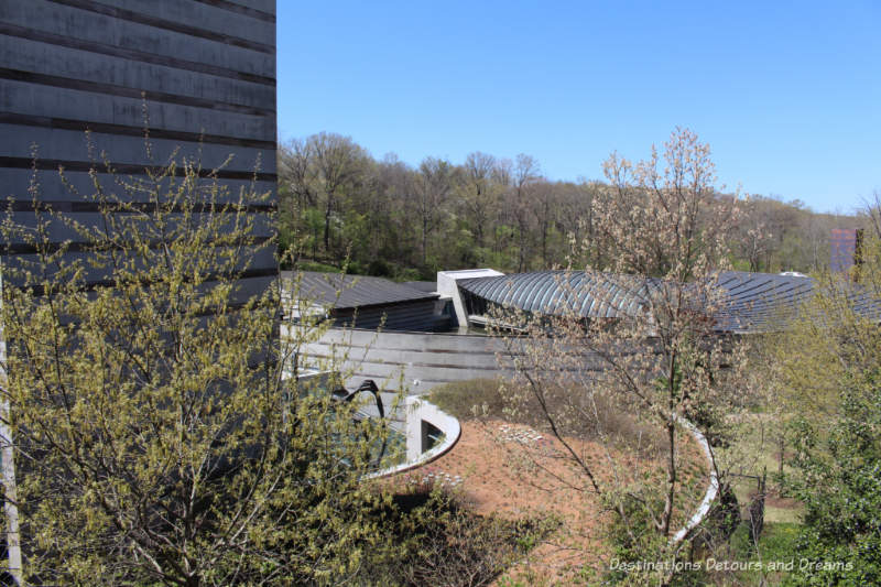 View of Crystal Bridges Museum of American Art building from the entrance point above the ravine the museum is set in