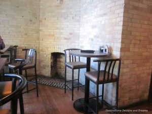 Original fireplace in a corner of the Saddlery on Market restaurant in Winnipeg's Exchange District