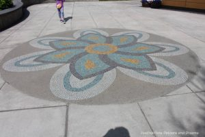 Mosaic design on sidewalk in front of Morris Thompson Cultural and Visitor Center in Fairbanks, Alaska
