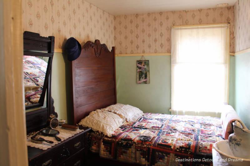 Bedroom in Hazel Cottage at Nellie McClung Heritage Site