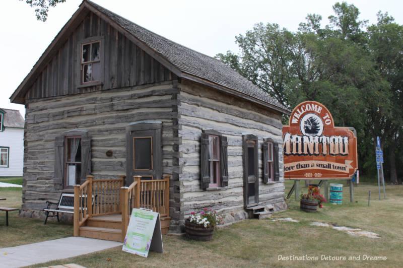 log cabin Manitou Tourism Centre