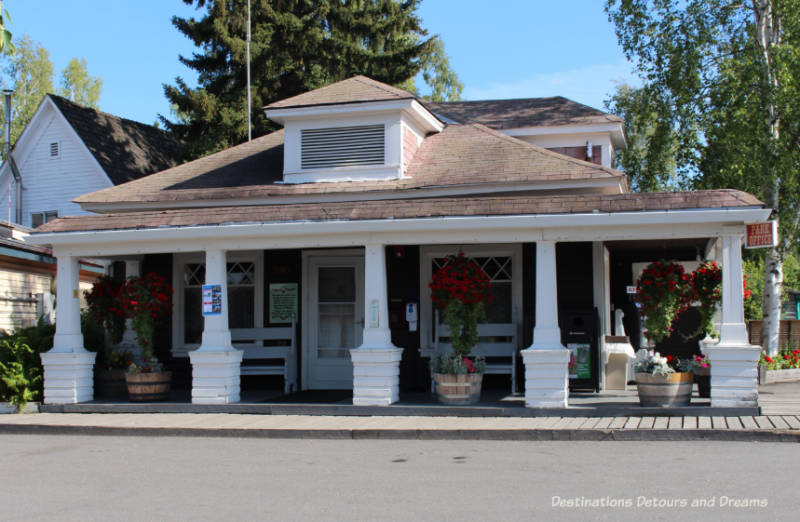 Georgia Lee House with covered front porch and decorative pillars in Pioneer Park in Fairbanks, Alaska