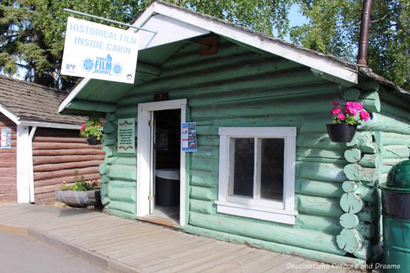 Turquoise log cabin in Pioneer Park Fairbanks, Alaska