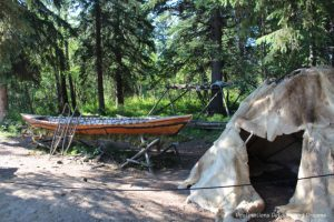 Birch canoe and temporary dwelling at display about nomadic Athabascan life at Chena Village in Fairbanks, Alaska