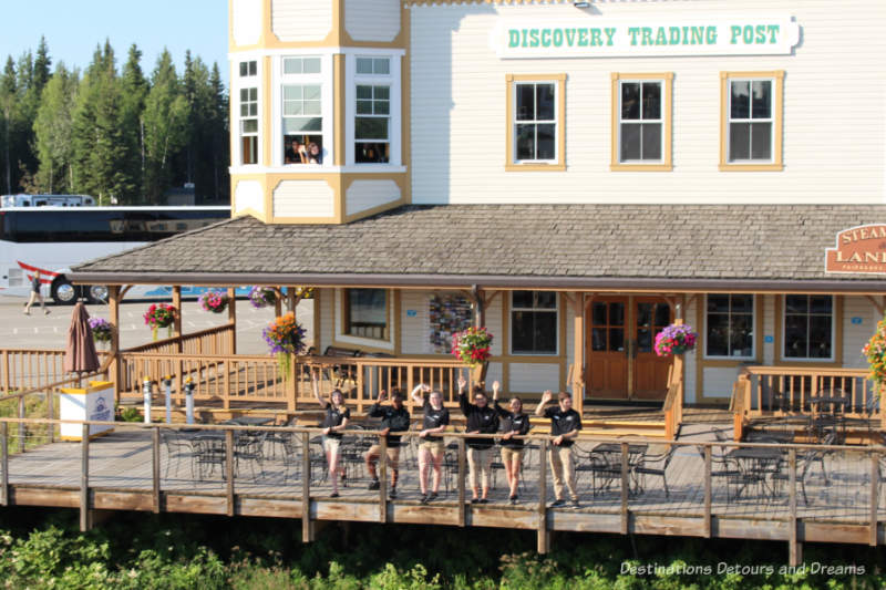 Staff waving us off as we being our sternwheeler excursion aboard the Riverboat Discovery in Fairbanks, Alaska