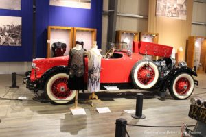 Flappers and their vehicle at Fountainhead Antique Auto Museum