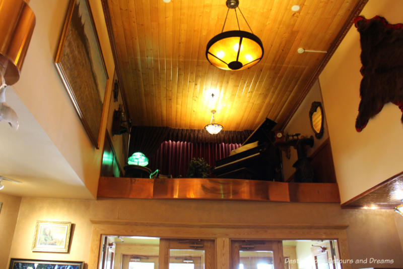 Grand piano in an elevated nook in the lobby of Pike's Waterfront Lodge in Fairbanks, Alaska