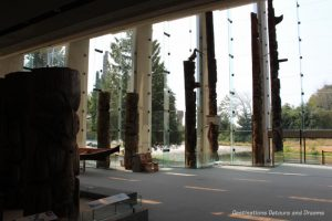 Museum of Anthropology Great Hall and tall windows with view of mountains and forest beyond