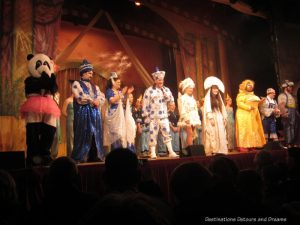 """The cast from the pantomime """"Aladdin"""" at Princes Hall in Aldershot, Hampshire, England 2017"""