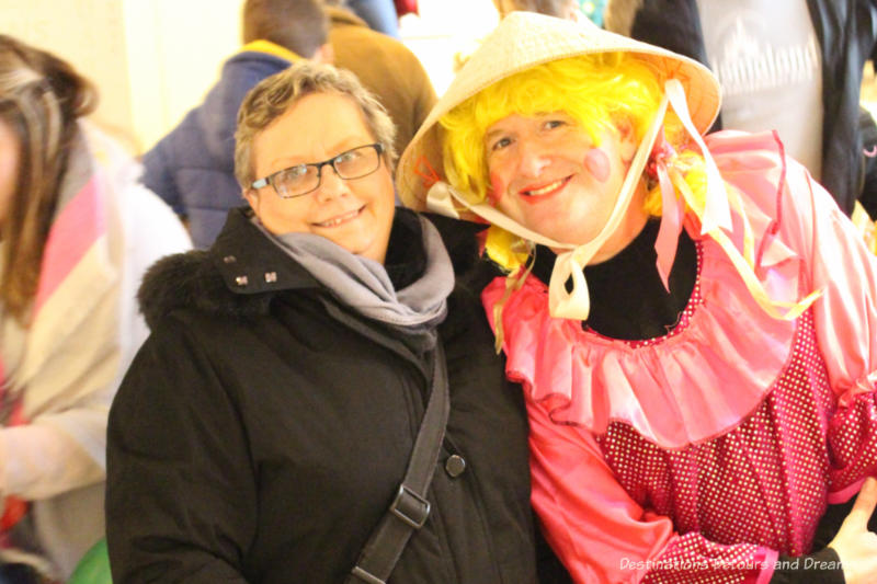 Posing with a pantomime actor