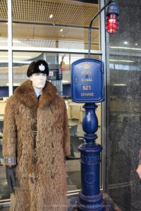 Call box and police officer in an iconic buffalo coat at the Winnipeg Police Museum