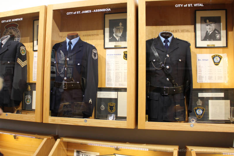 Displays of pre-amalgamation community police forces at Winnipeg Police Museum