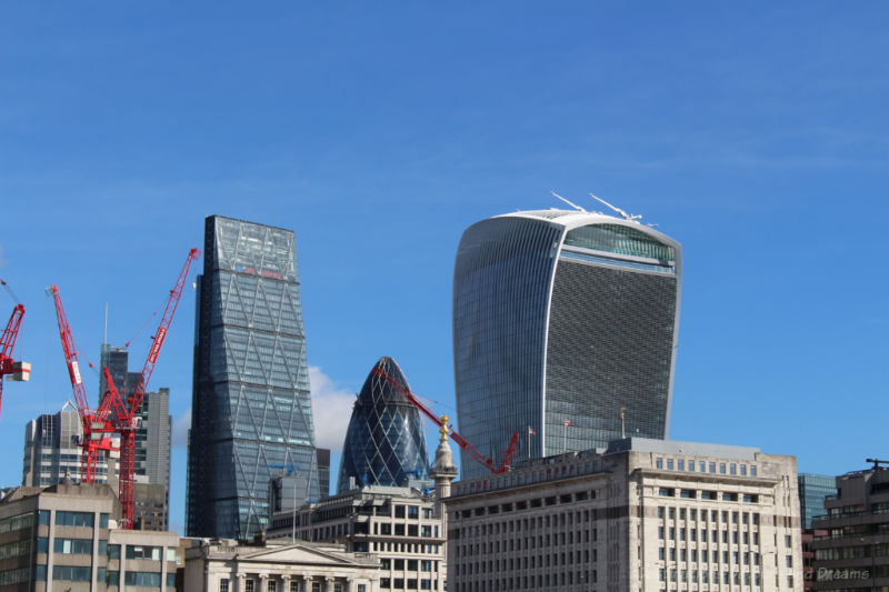 Three twenty-first century buildings in London's skyline: buildings nicknamed the Cheesgrater, the Gherkin, and the Walkie-Talkie.