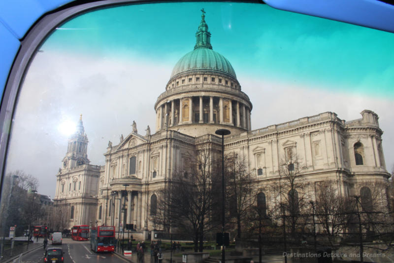 View of the side of St Paul's Cathedral from the top of a double-decker bus.