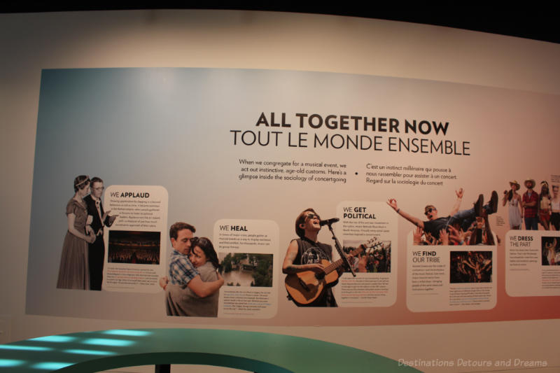 Wall at Studio Bell National Music Centre outlining how we get together with music (applaud, heal, political, find our tribe)