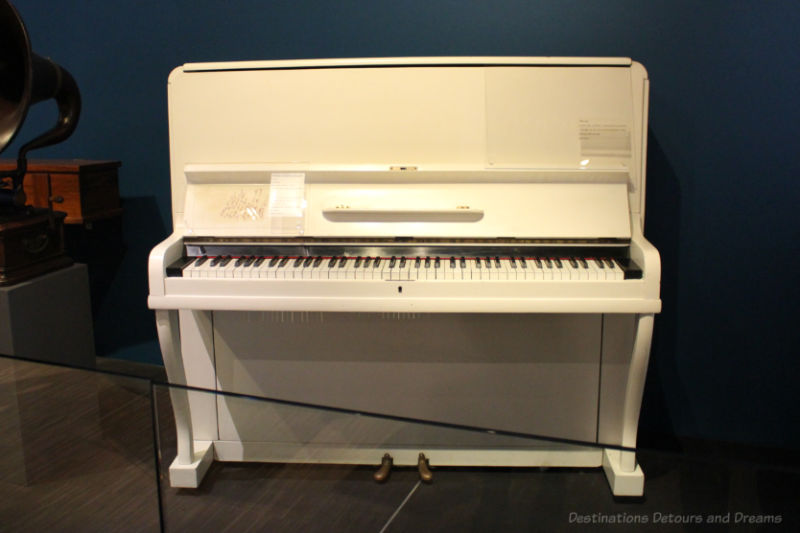 "Vertical white ""birdcage"" piano, circa 1910"