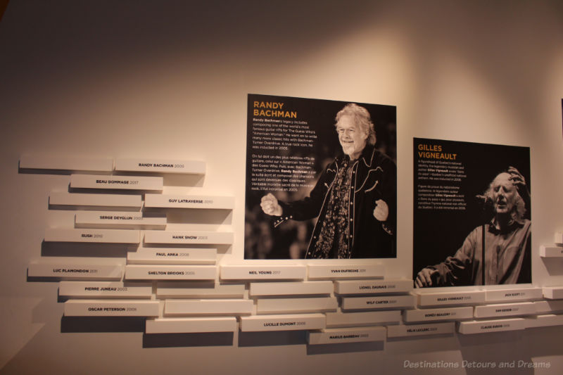 Names and photos of musicians on the wall of the Halls of Fame gallery in the National Music Centre