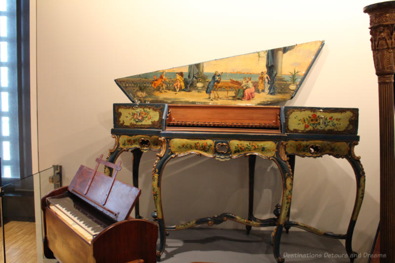 1890 Harmonium and 1560 colourfully decorated Virginal