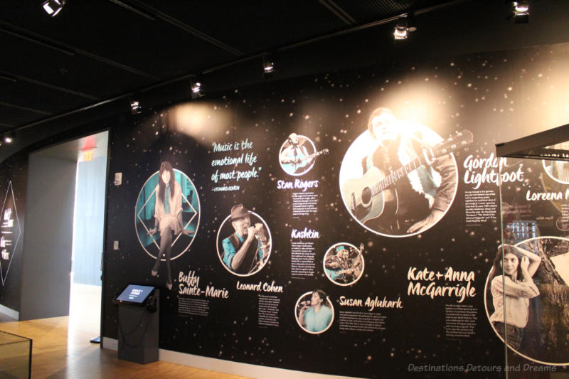 Wall with photos and information highlighting some of the musicians featured in the Idols and Icons gallery of the National Music Centre