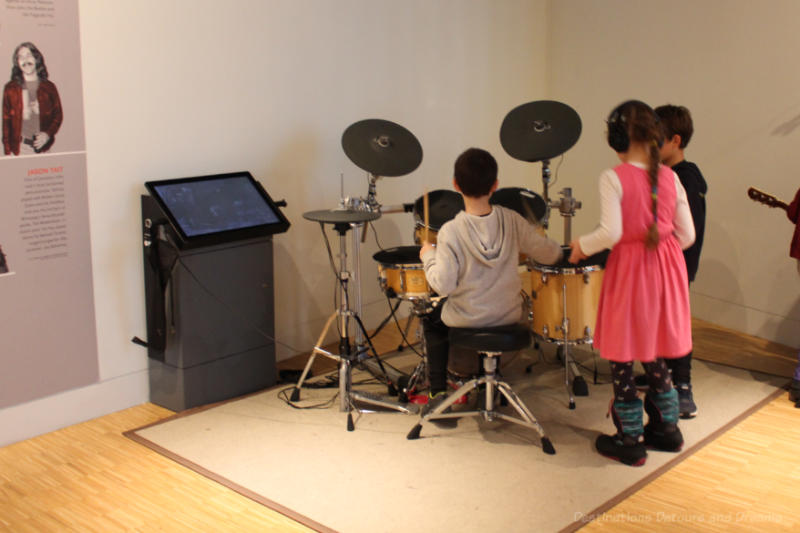 A group of children playing the drums at the National Music Centre