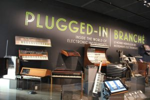 A group of electronic instruments and synthesizers in the Plugged In gallery at National Music Centre