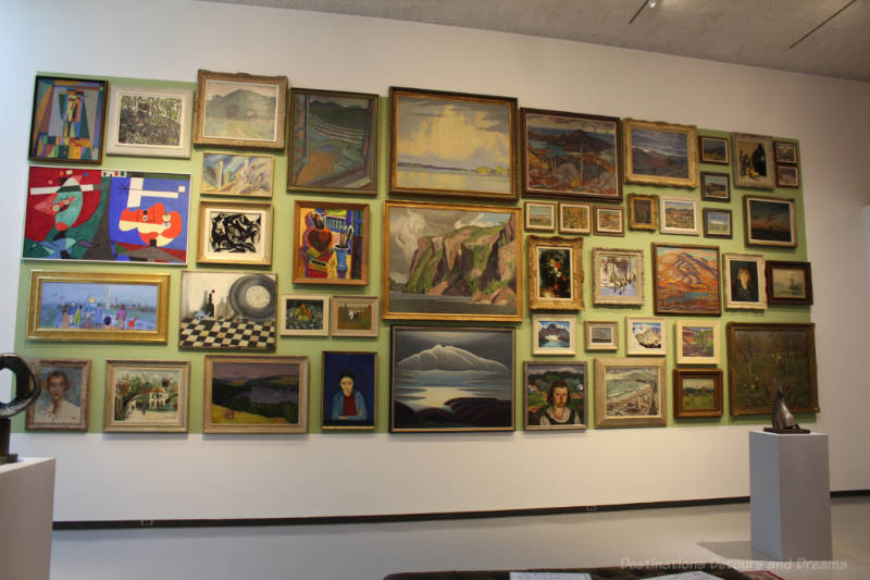 One of the walls in the Winnipeg Art Gallery's Salon Style exhibition covered with paintings close together