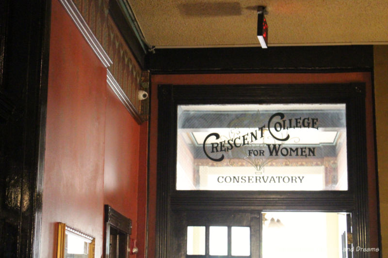 Sign for Crescent College for Women on day to conservatory at Crescent Hotel