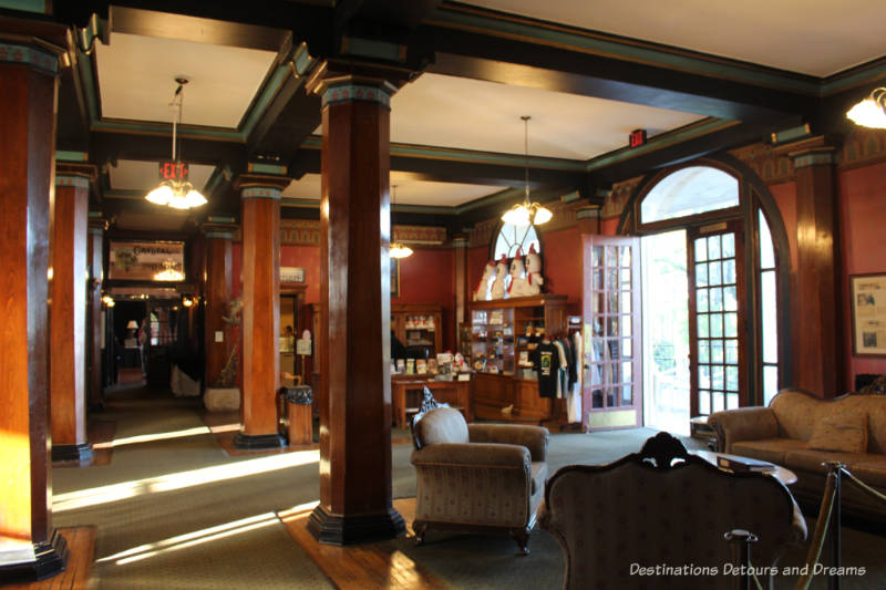 Lobby of Crescent Hotel with period furnishings and dark wood trim